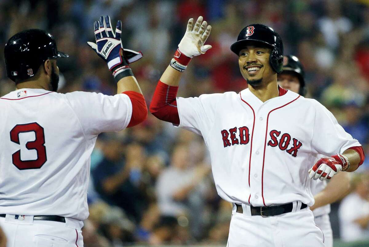Mookie Betts, right, celebrates his solo home run with Sandy Leon during the fifth inning.