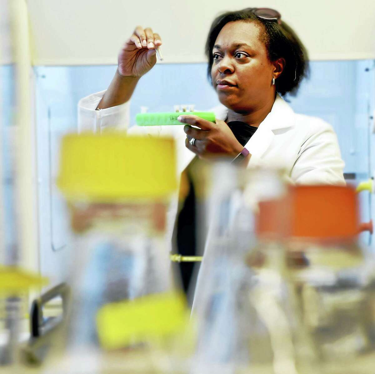 (Peter Hvizdak - New Haven Register)Professor Elizabeth Lewis Roberts of Southern Connecticut University, a microbiologist and mycologist who studies plant microbe interactions, has discovered that there's a fungus found in certain types of grasses that actually make the grasses more resilient. This fungus attracts bacteria that protects the grass and helps it stay healthy. Monday, April 11, 2015.