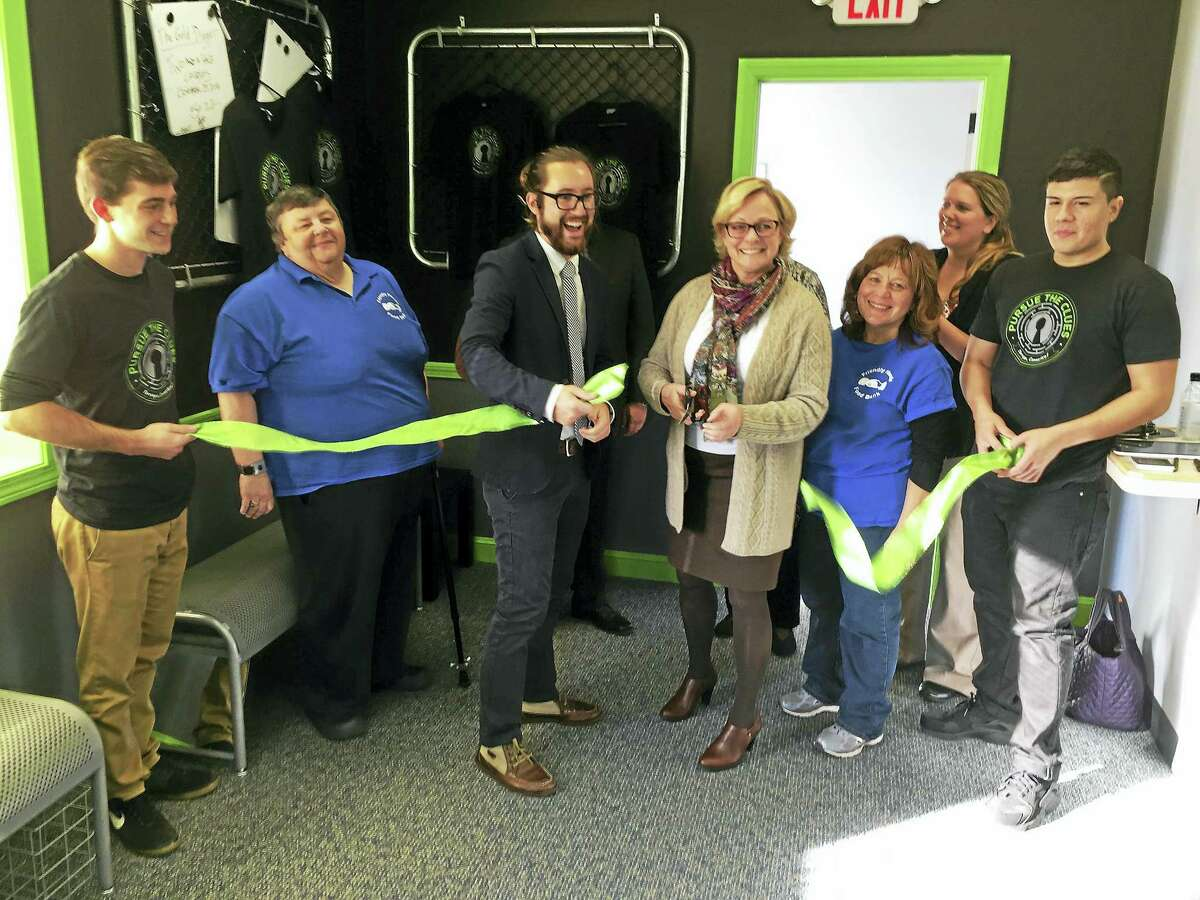 """The opening of """"Pursue the Clues,"""" was celebrated Wednesday afternoon, as Mayor Elinor Carbone, representatives of the Friendly Hands Food Bank and other city officials took part in a ribbon-cutting ceremony."""
