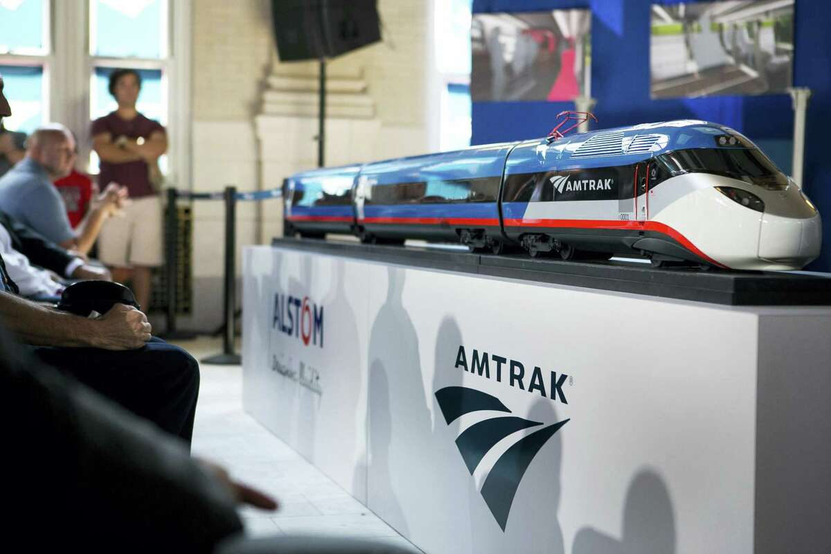 A model of a new Amtrak train is displayed at the Joseph R. Biden Jr. Railroad Station in Wilmington, Del., Friday, Aug. 26, 2016. Federal officials say the government will make a $2.45 billion loan to Amtrak to buy new trains, upgrade tracks and make platform improvements on the Northeast corridor.
