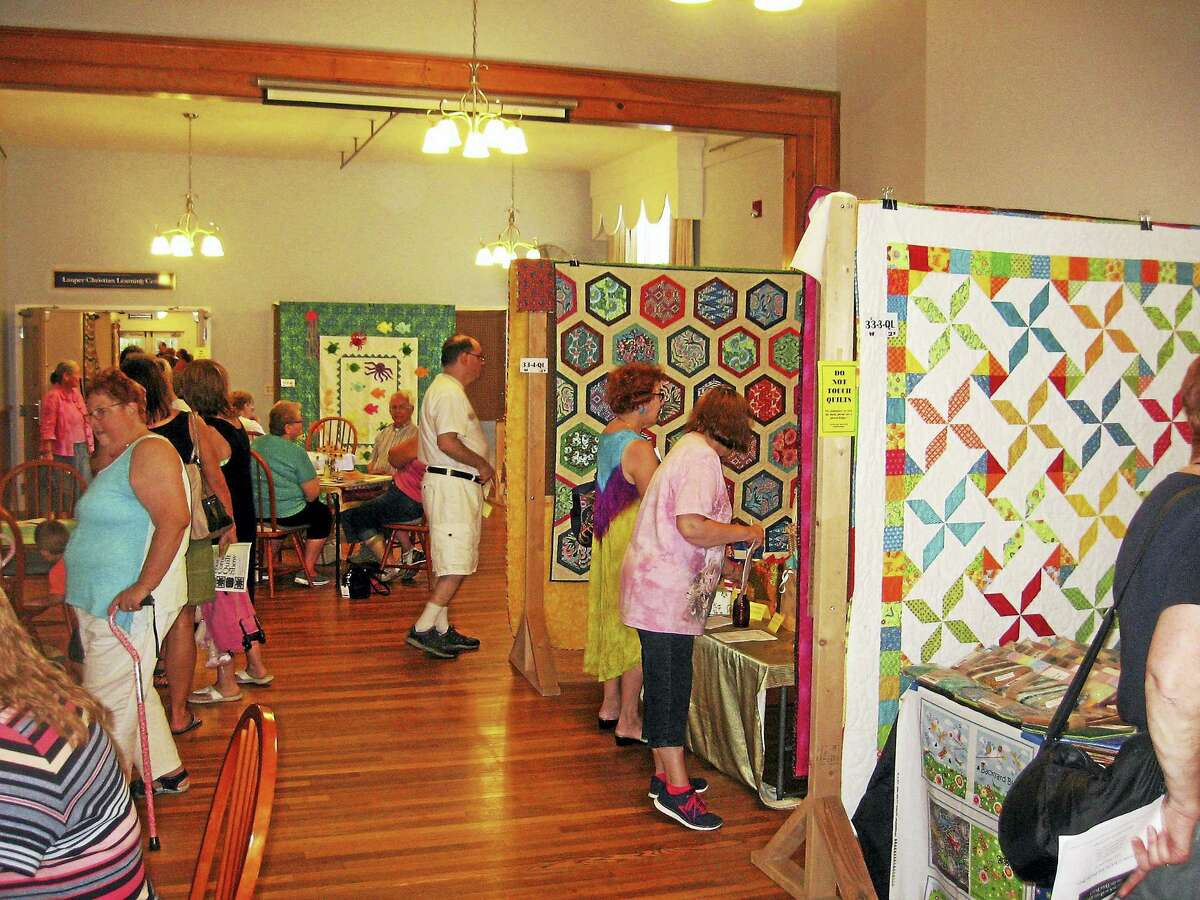 Visitors browse through the Four Corners Quilt Show Saturday.