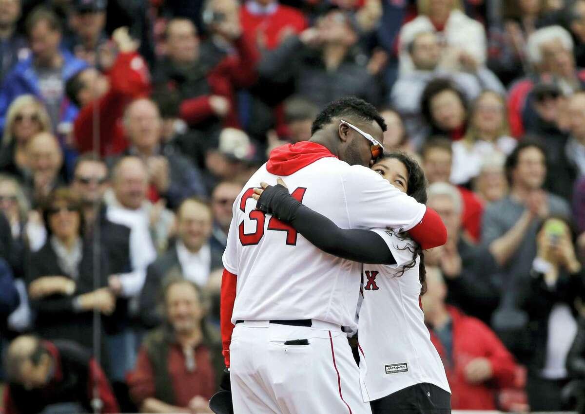 David Ortiz hugs his daughter, Alex, after she sang the national anthem Monday.