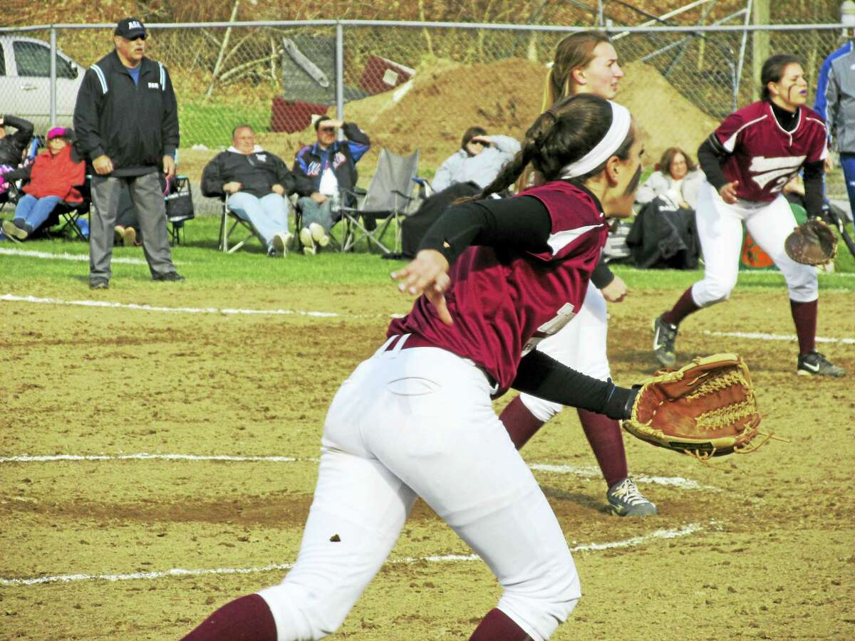 Torrington third baseman Carissa Carbone charges a Seymour bunt while pitcher Ali Dubois and first baseman Amanda Thiel stand ready in Seymour's 4-0 softball win Monday afternoon.