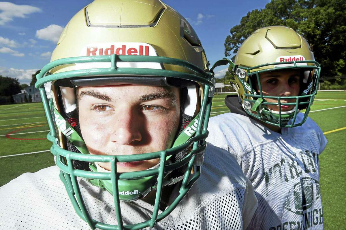 Notre Dame linebackers Tristan Andrzejewski, left, Frank Longley are photographed wearing Riddell Flex helmets outfitted with the Reddell Insite sensor system inside.