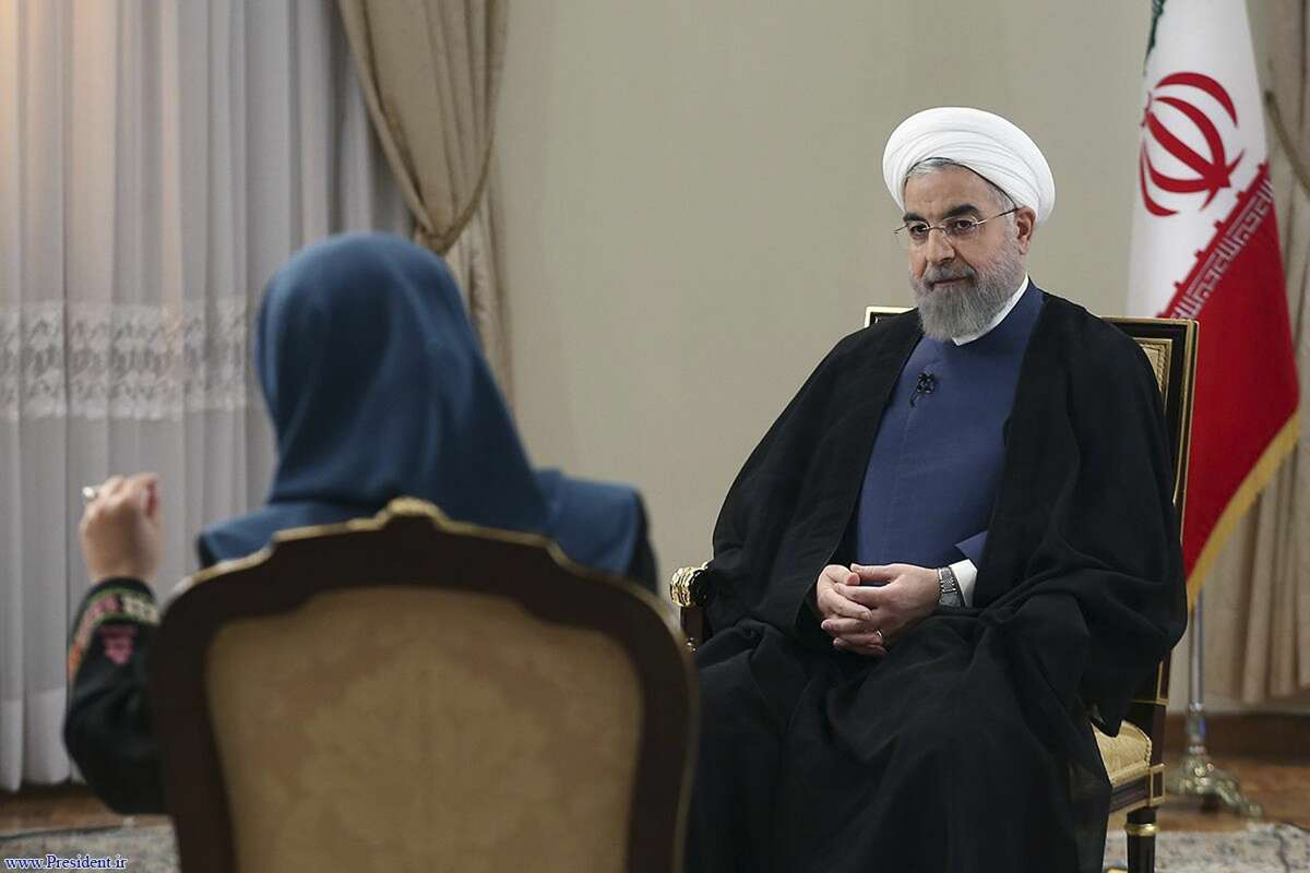 In this photo released by the official website of the office of the Iranian Presidency on Aug. 2, 2015, Iran's President Hassan Rouhani, right, listens to a question in an interview with the state-run TV at the presidency office in Tehran, Iran.
