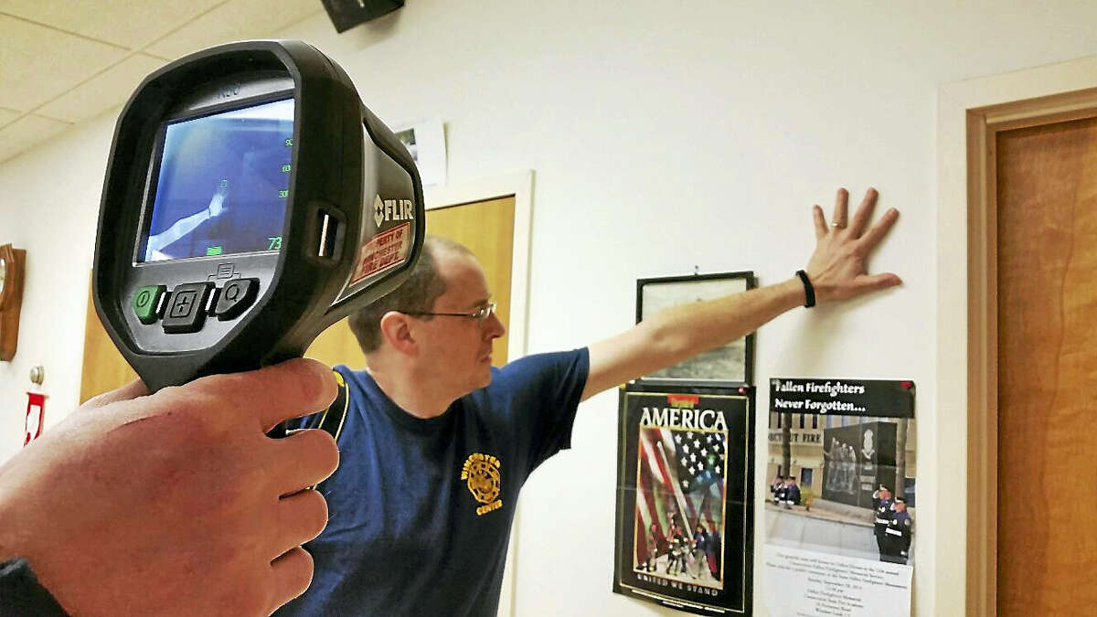 N.F. Ambery photo Members of the Winchester Volunteer Fire Department prepared to demonstrate a heat impression left by a hand using a thermal imaging camera.