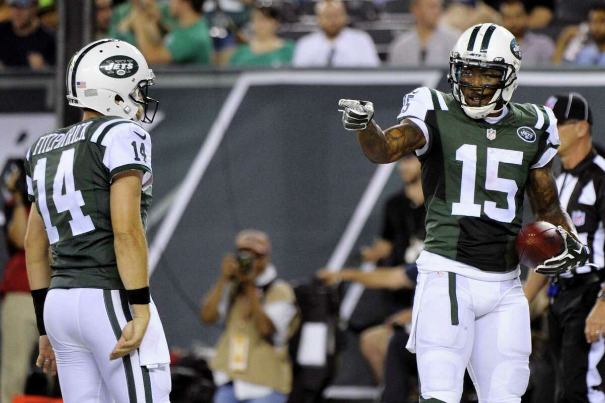 Jets wide receiver Brandon Marshall (15) gestures to quarterback Ryan Fitzpatrick after they scored on a two point conversion during a preseason game against the Falcons.
