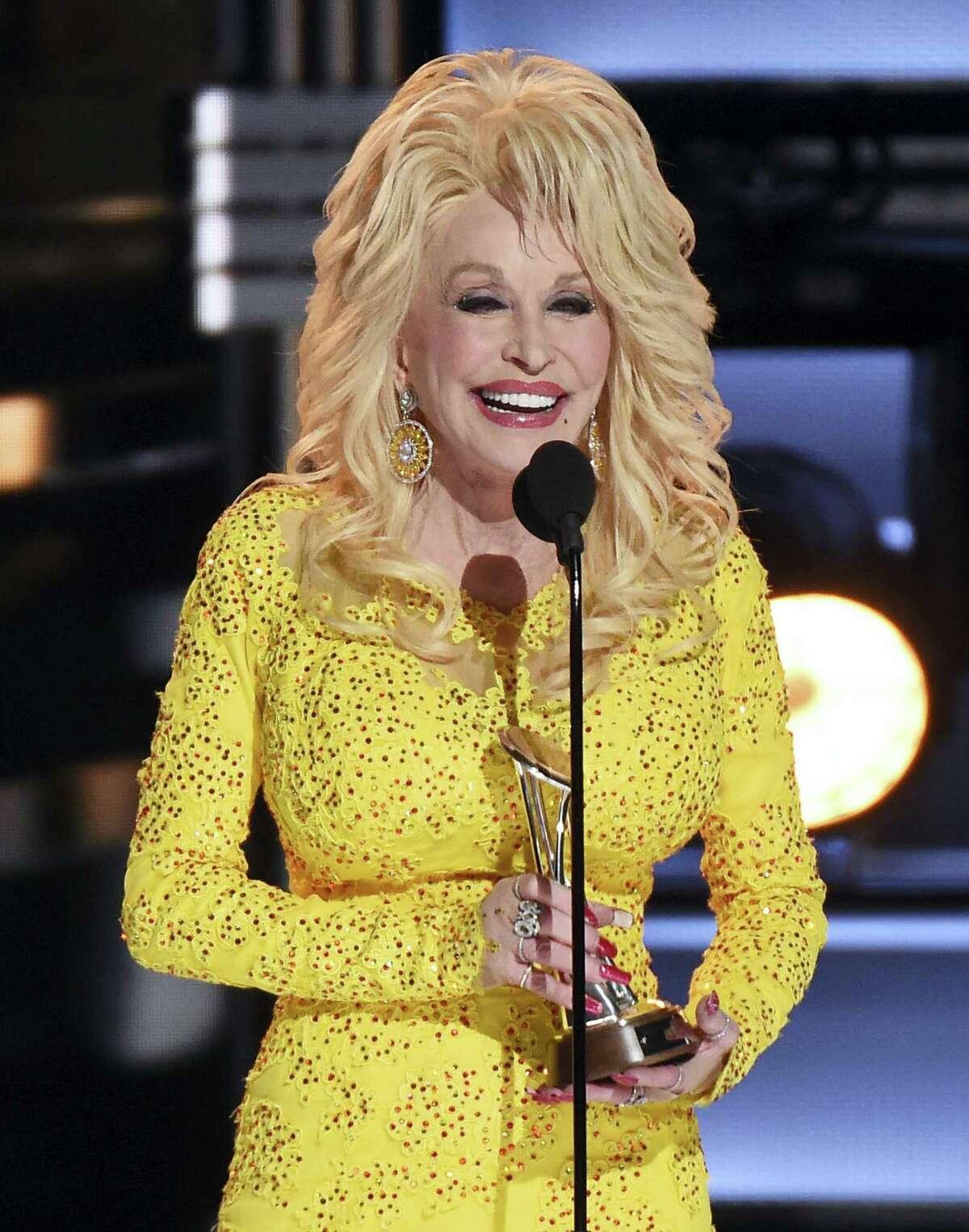 Dolly Parton accepts the Willie Nelson Lifetime Achievement Award at the 50th annual CMA Awards at the Bridgestone Arena on Nov. 2, 2016 in Nashville, Tenn.