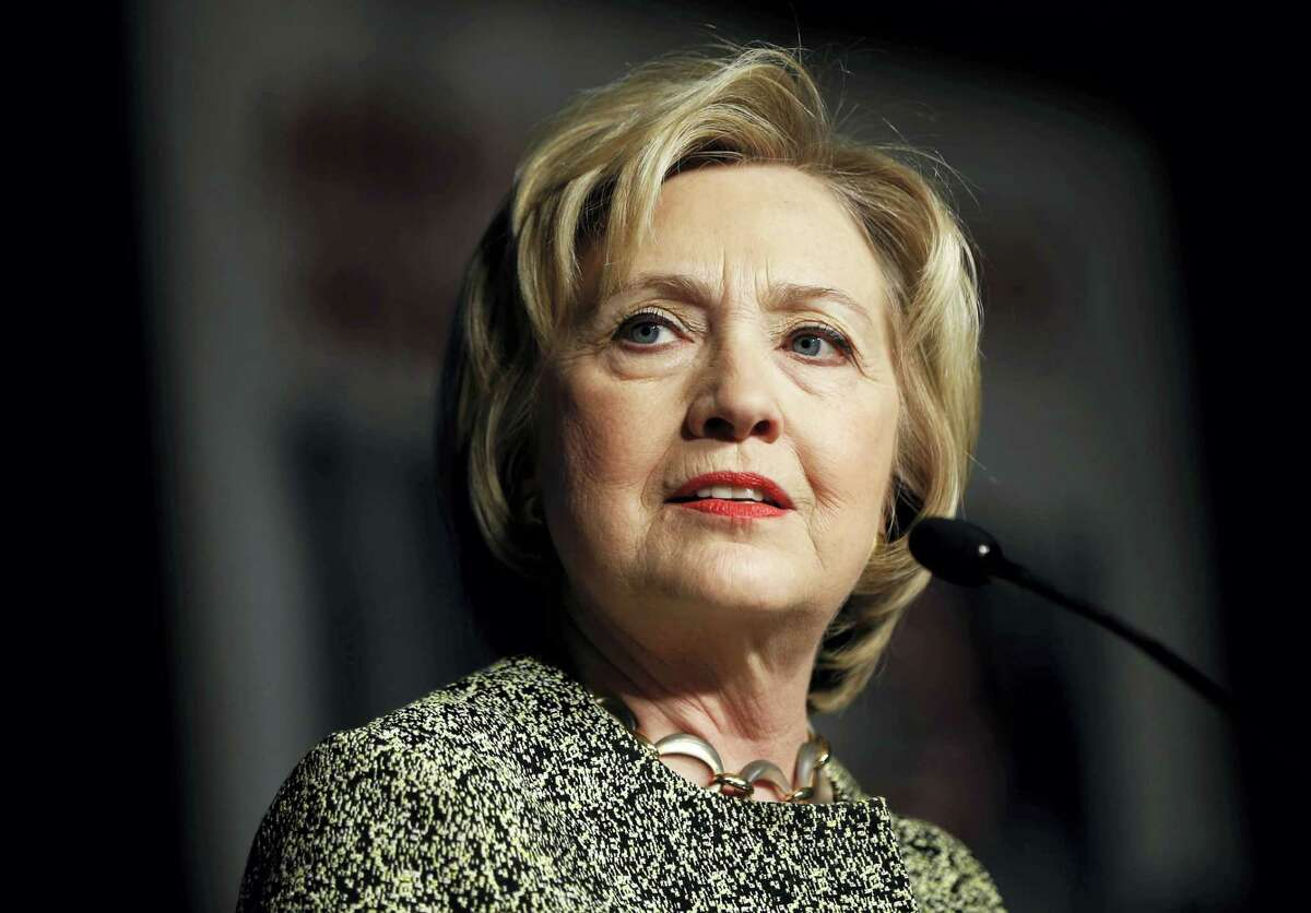 In this April 6, 2016 photo, Democratic presidential candidate Hillary Clinton speaks at the Pennsylvania AFL-CIO Convention in Philadelphia. A new Associated Press-GfK poll finds that Americans trust Democratic presidential front-runner Clinton more than Republican leader Donald Trump to handle a wide range of issues, from immigration to health care to nominating Supreme Court justices.