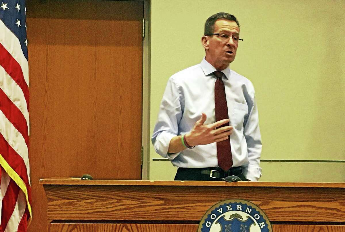 Gov. Dannel P. Malloy and Lt. Gov. Nancy Wyman host a town forum in Middletown's Council Chambers to address Malloy's proposed budget reductions and how the state is adapting to the changing economy. (Middletown Press photo)