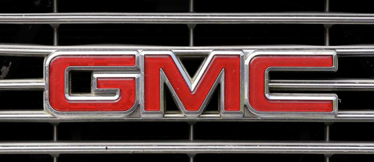 A GMC logo is seen on the grill of a pickup truck Tuesday, July 8, 2014 in Pembroke, Mass.