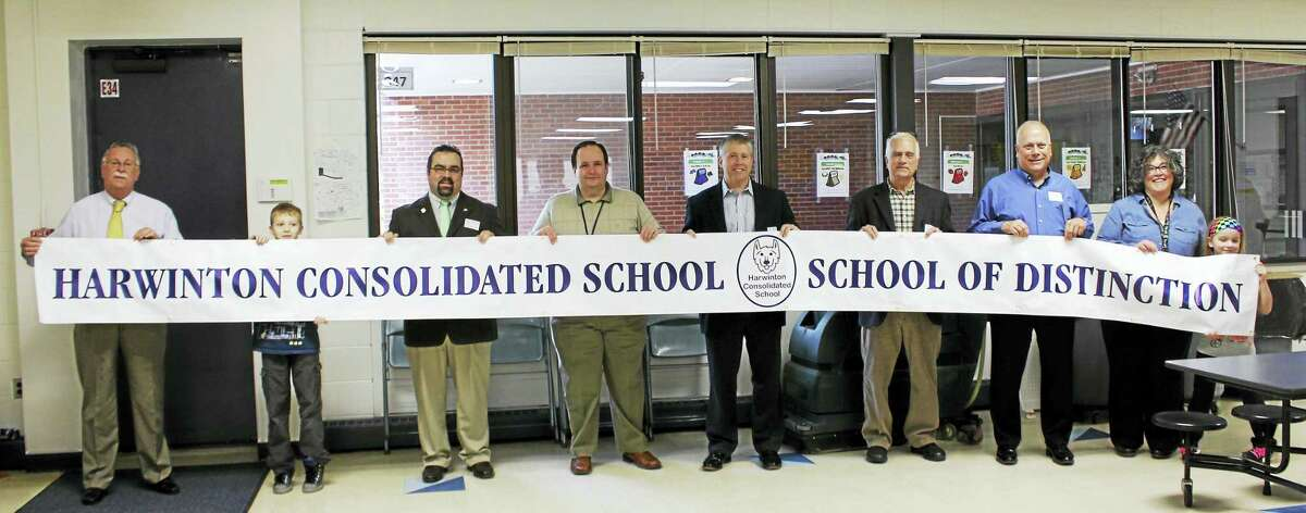 Contributed photoFrom left, Superintendent Alan Beitman, third-grader Nicholas Ballerini, Harwinton First Selectman Mike Criss, Board of Education members Phil Penn, Bruce Guillemette, John Vecchitto and Tom Fausel, Harwinton Consolidated Principal Megan Mazzei and third-grader Morgan Murray.