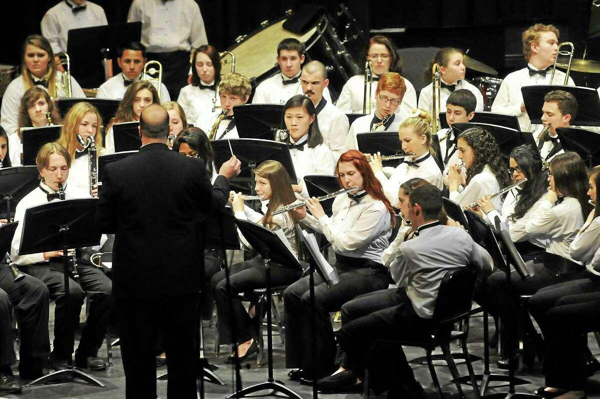 The Torrington High School Symphonic Band performs at the Warner Theatre in Torrington, directed by Wayne Splettstoeszer.