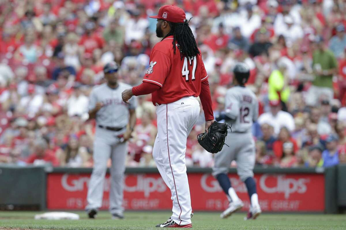 Cleveland Indians' Francisco Lindor (12) heads to first base after being walked by Cincinnati Reds starting pitcher Johnny Cueto (47) in the second inning of a baseball game, Sunday, July 19, 2015, in Cincinnati. (AP Photo/John Minchillo)