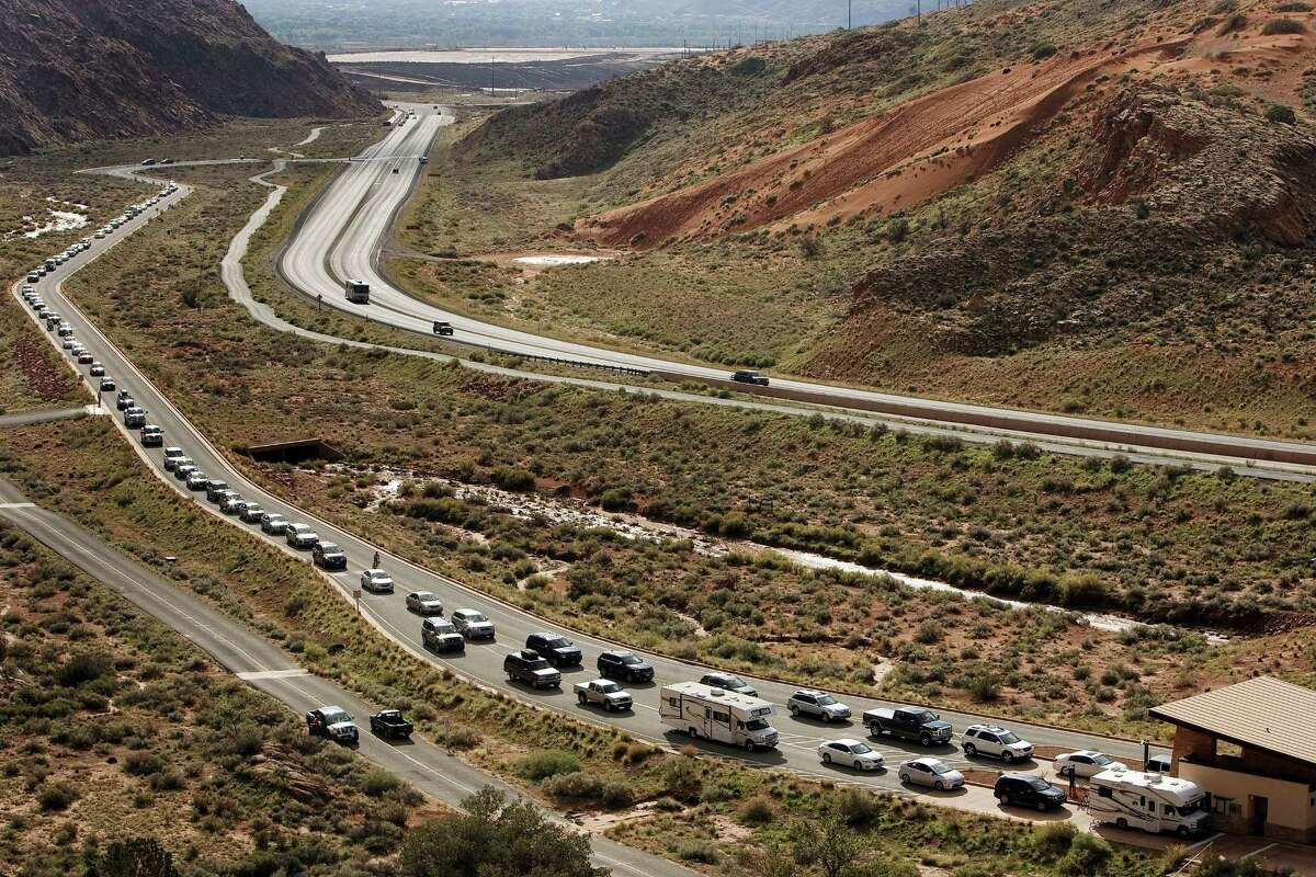 Vehicles wait at the entrance to Arches National Park in Utah.