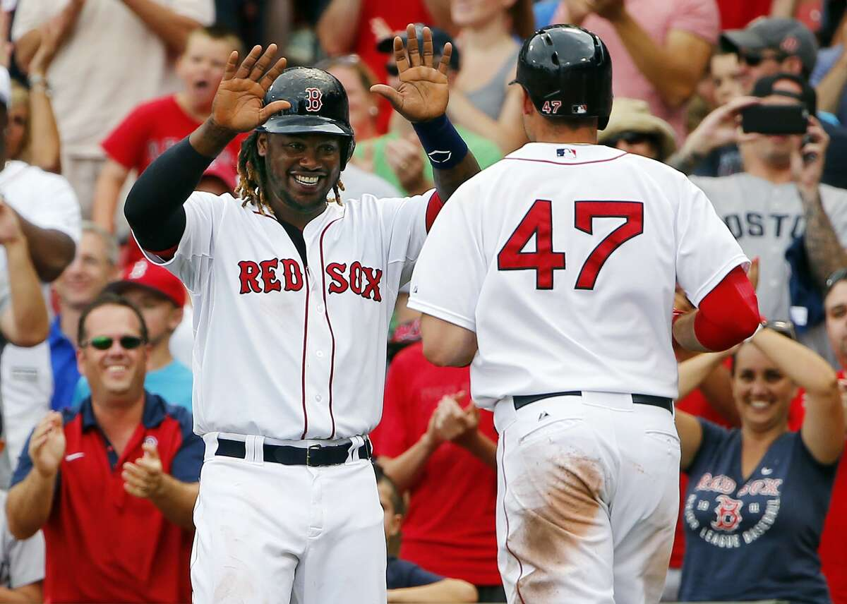 Boston's Hanley Ramirez greets Travis Shaw (47) after Shaw's second home run during the eighth inning of an 11-7 win over the Tampa Bay Rays at Fenway Park in Boston, Saturday.