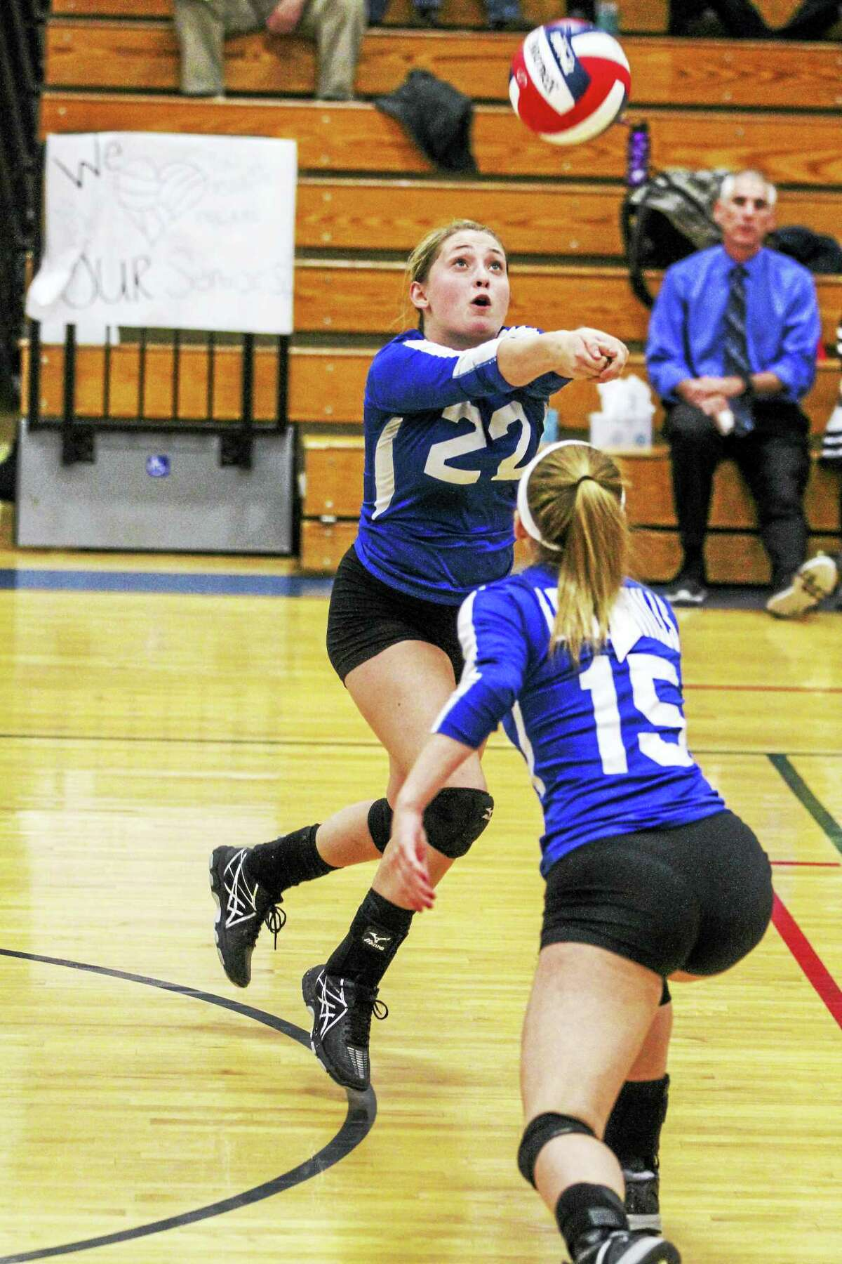 Lewis Mills setter Arlee Twitchell (22) had 28 assists in the Spartans' win over Ellington Wednesday night at Lewis Mills High School.