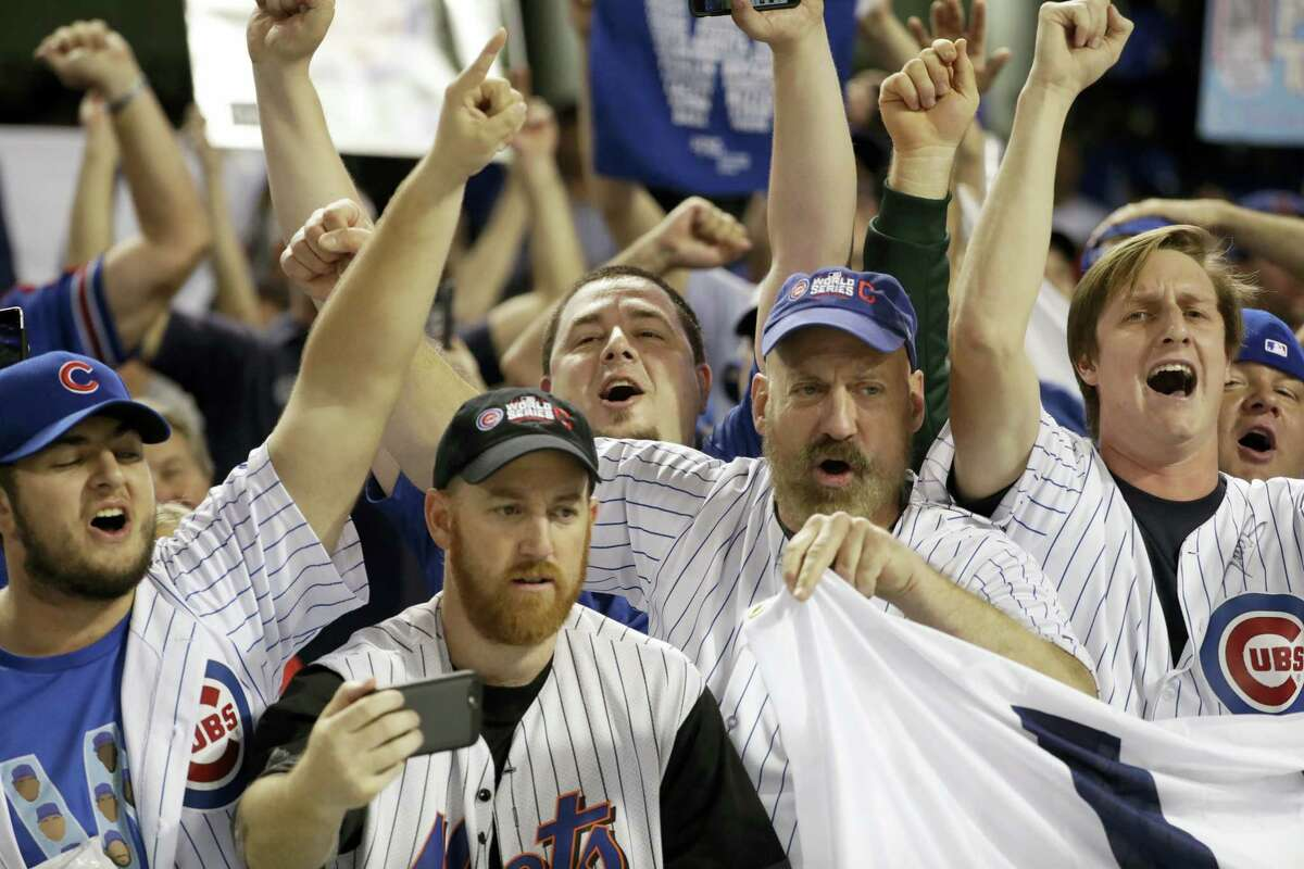 Chicago Cubs fans cheer at Progressive Field after Game 6 of the World Series. The Cubs won 9-3 to tie the series 3-3.