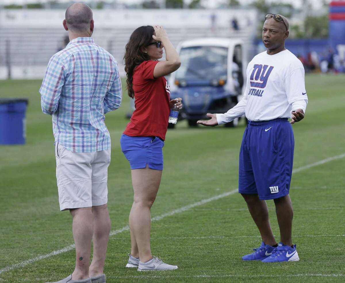 New York Giants general manager Jerry Reese, right, looks on during Sunday's practice in East Rutherford, N.J.