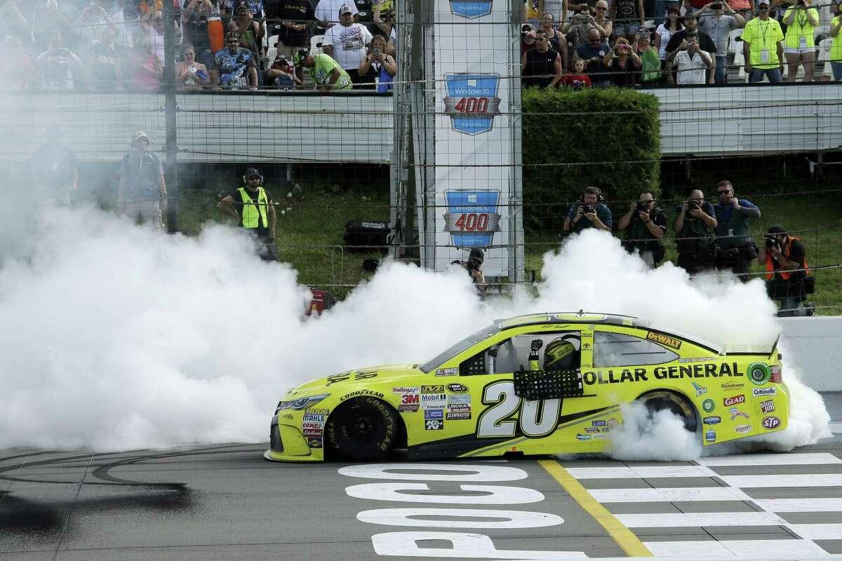 Matt Kenseth smokes his tires after winning the NASCAR Pocono 400 Sunday in Long Pond, Pa.