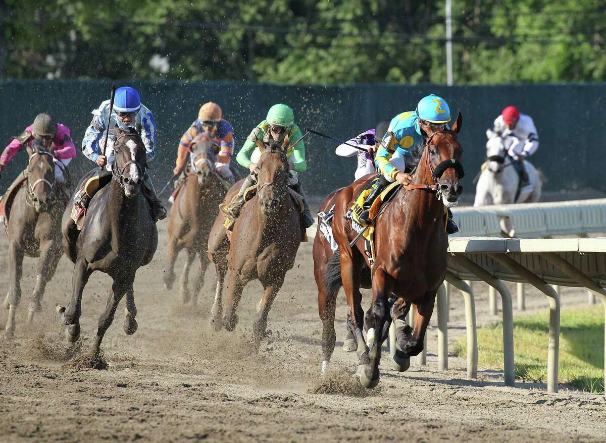 American Pharoah pulls away from the field around the final turn en route to a win in the Haskell Invitational at Monmouth Park on Sunday.