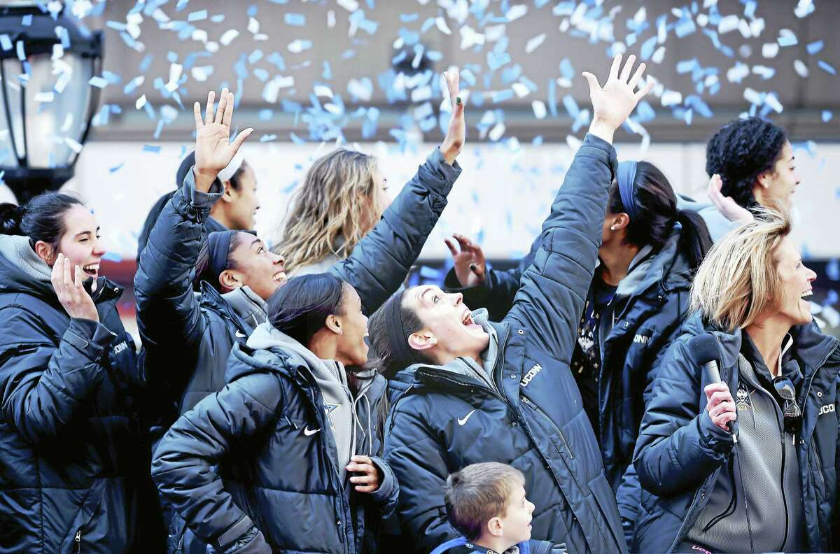 (Arnold Gold-New Haven Register) UCONN's Breanna Stewart (center) and her teammates react to confetti blanketing the area at a victory rally for the 2016 NCAA Women's Basketball National Championship team in front of the XL Center in Hartford on 4/10/2016.
