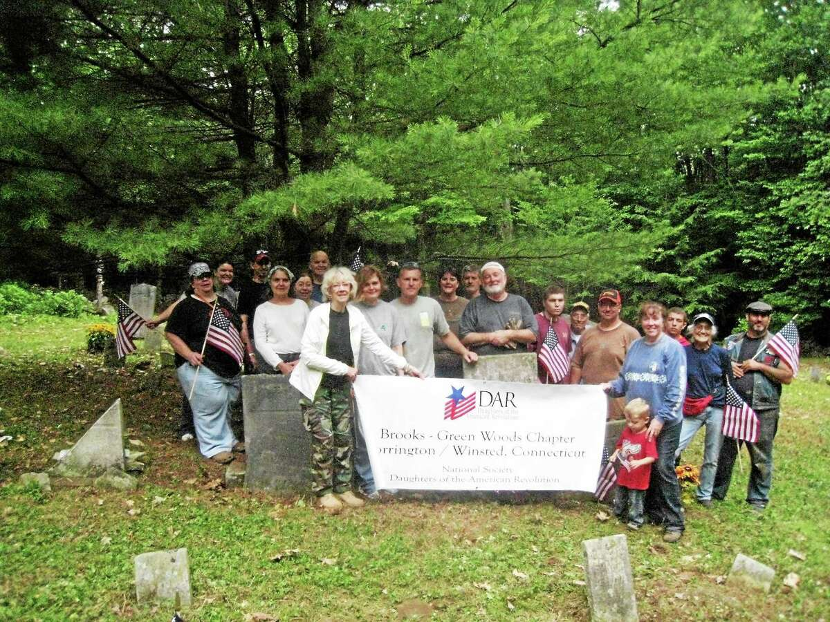 Photos submitted by Maureen Markure, Publicity Chairman, Brooks-Green Woods Chapter, NSDAR, Winsted Members of the Brooks-Greenwoods Chapter, Daughters of the American Revolution, and their families spent the day at the Danbury Quarter Cemetery, clearing brush and overgrowth around the neglected burial ground, where many of Winchester's families and soldiers are buried.