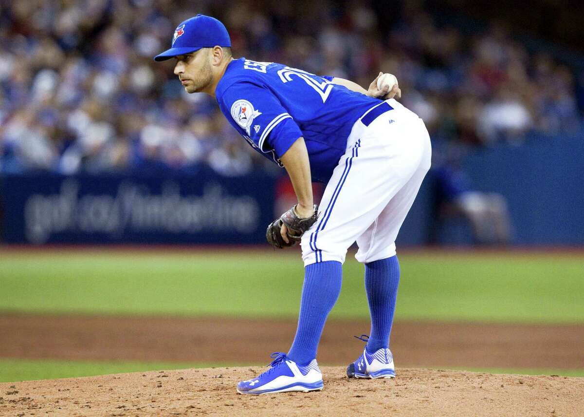 Toronto Blue Jays starting pitcher Marco Estrada looks in for a sign against the Boston Red Sox during the seventh inning of their American League baseball game in Toronto on Sunday, April 10, 2016. (Fred Thornhill/The Canadian Press via AP) MANDATORY CREDIT