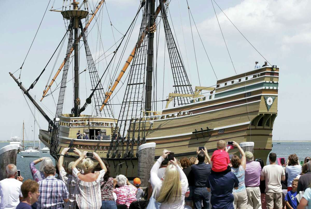 In this June 6, 2016, file photo, people on a wharf watch as the Mayflower II arrives in Plymouth Harbor in Plymouth, Mass. The 60-year-old replica of the ship that carried the Pilgrims to Massachusetts in 1620 was being towed Tuesday, Nov. 1, 2016, to Mystic, Conn., for major reconstruction that's expected to take 2½ years.