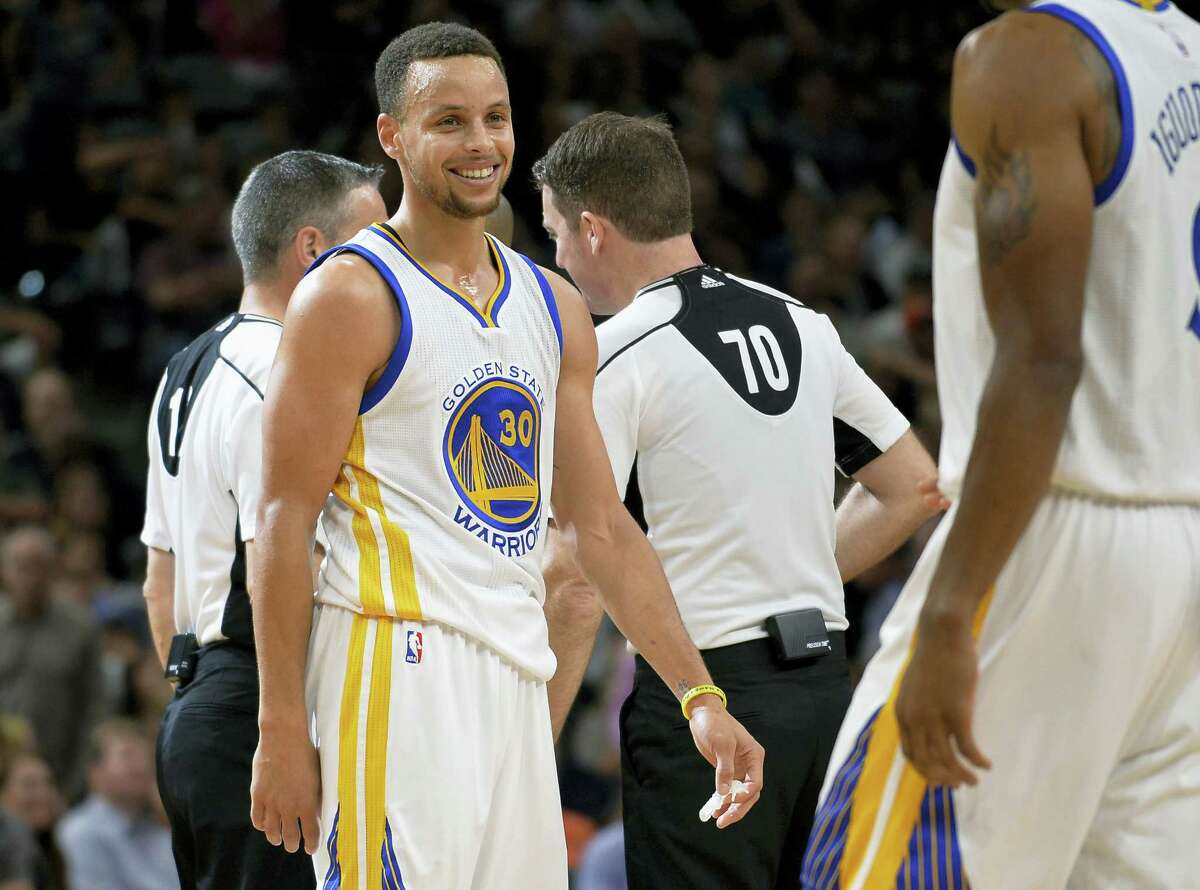 Golden State Warriors guard Stephen Curry (30) smiles during the second half against the San Antonio Spurs Sunday in San Antonio. Golden State won 92-86 to tie the 1995-96 Bulls record of 72 wins in a single season.