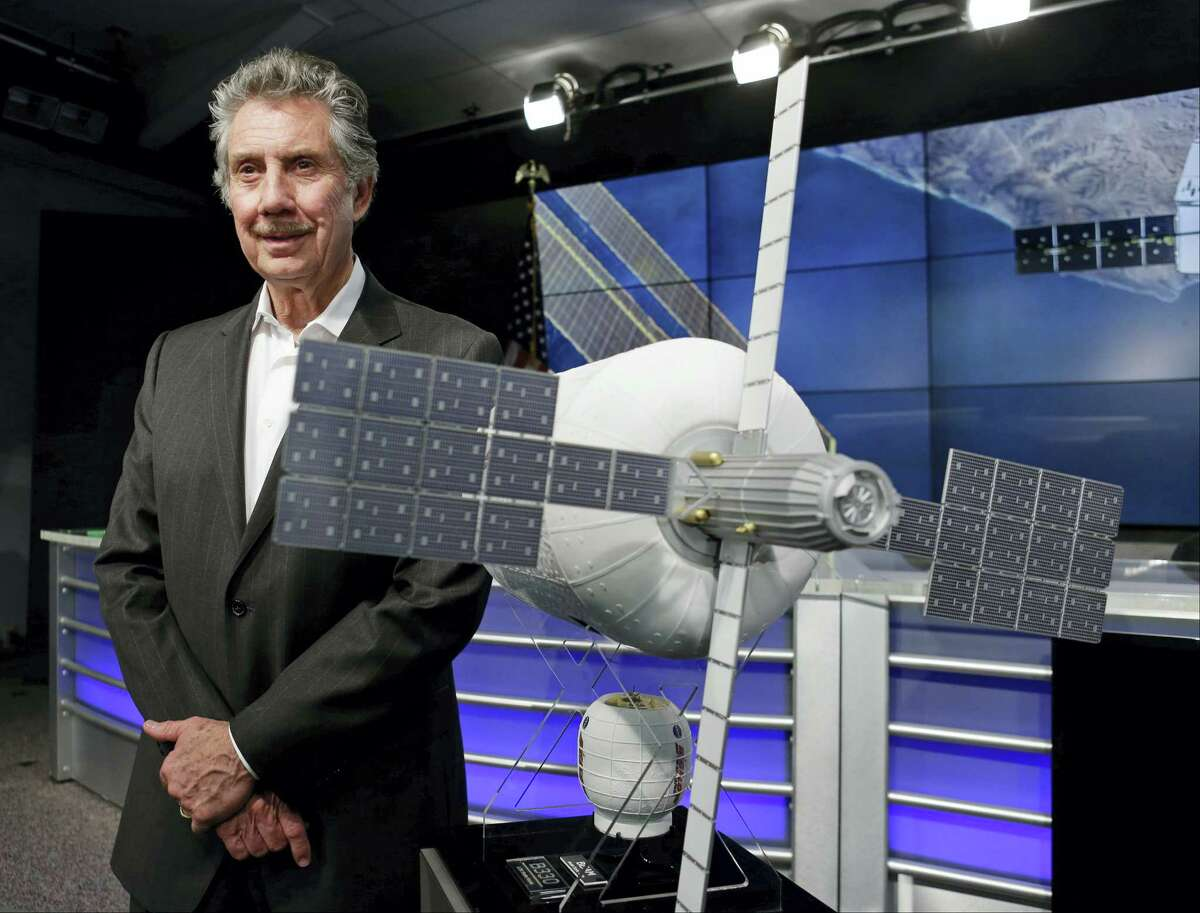 Robert Bigelow, founder and president of Bigelow Aerospace stands next to a model of an inflatable habitat that could be used for future space exploration during a news conference at the Kennedy Space Center in Cape Canaveral, Fla. on April 7, 2016.
