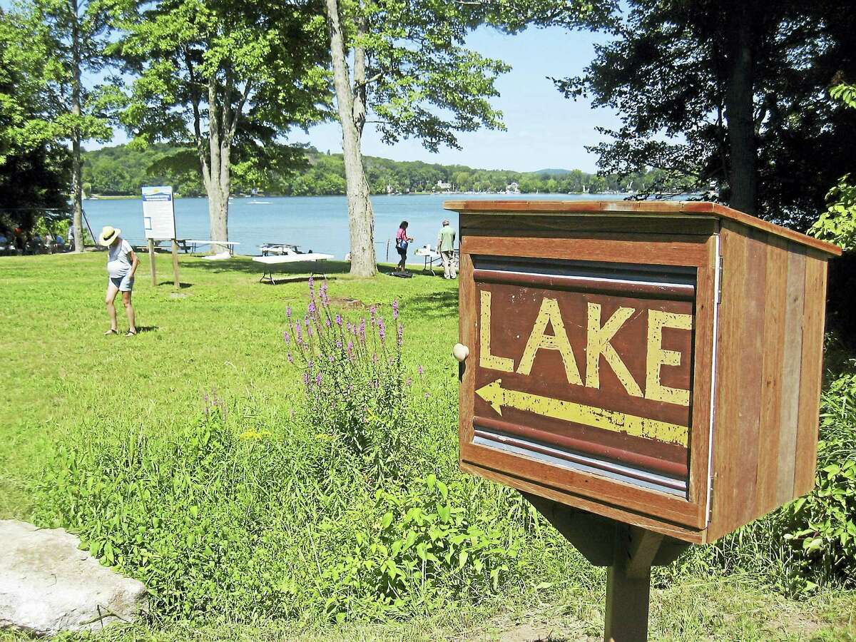 File photo - The Register Citizen The Morris Town Beach on Bantam Lake, one of three beaches in Litchfield and Morris, was deemed safe for swimming this week after an algae outbreak earlier this month resulted in its closure by the area health department.