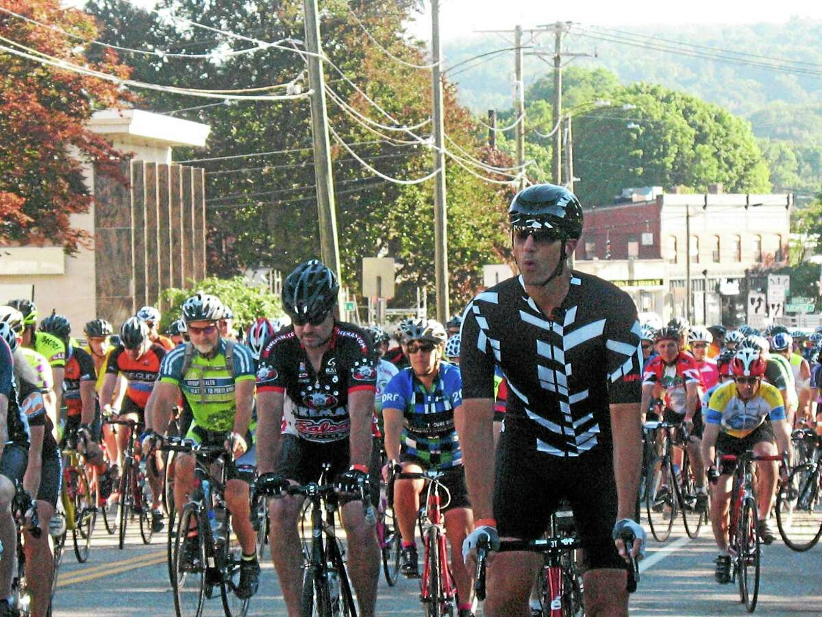 About 1,000 cyclists gathered Sunday morning at Coe Memorial Park for the 12th annual Tour of Litchfield Hills charity bike ride.