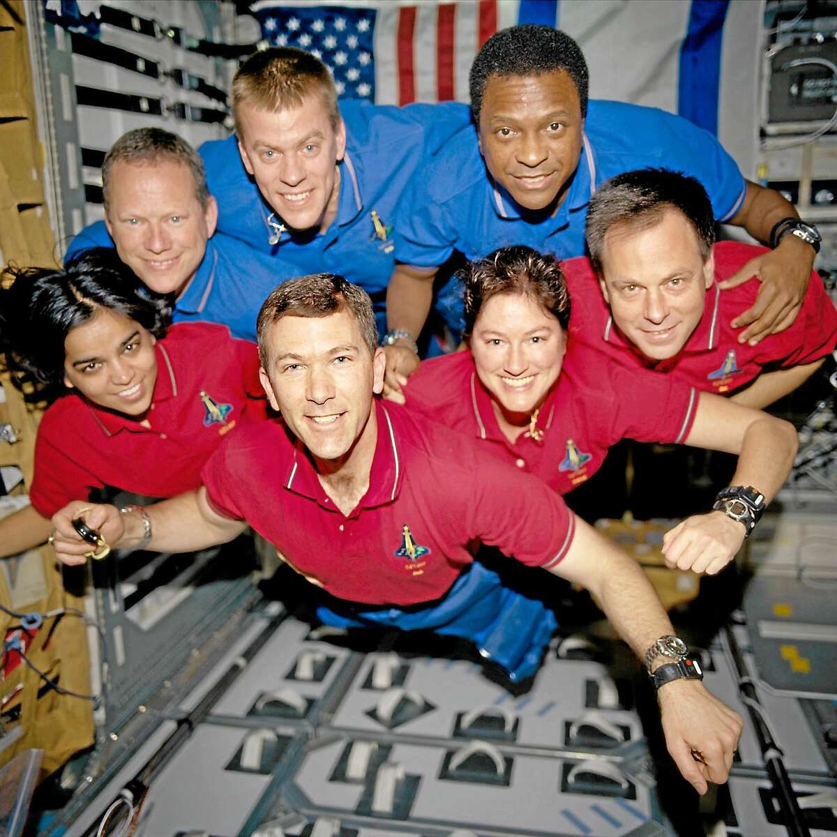 Associated Press ¬ This photo provided by NASA in June 2003 shows the Columbia crew. This picture was on a roll of unprocessed film later recovered by searchers from the debris. From the left are astronauts Kalpana Chawla, mission specialist; Rick D. Husband, mission commander; Laurel B. Clark, mission specialist; and Ilan Ramon, payload specialist. From the left (top row) are astronauts David M. Brown, mission specialist; William C. McCool, pilot; and Michael P. Anderson, payload commander.