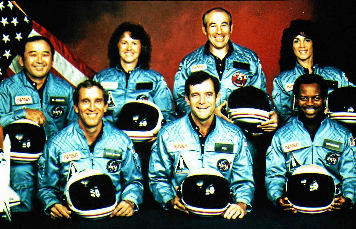 File picture from January 28, 1986 shows the crew of space shuttle Challenger. The space shuttle with seven astronauts on board exploded over Cape Canaveral/Florida 74 seconds after launch. All occupants were killed. In the front row, from left: Astronauts Mike Smith, Francis R. Scobee, Ronald E.McNair. Back row from left: Ellison S. Onizuka, Christa McAuliffe, Gregory Jarvis and Judy Resnik.
