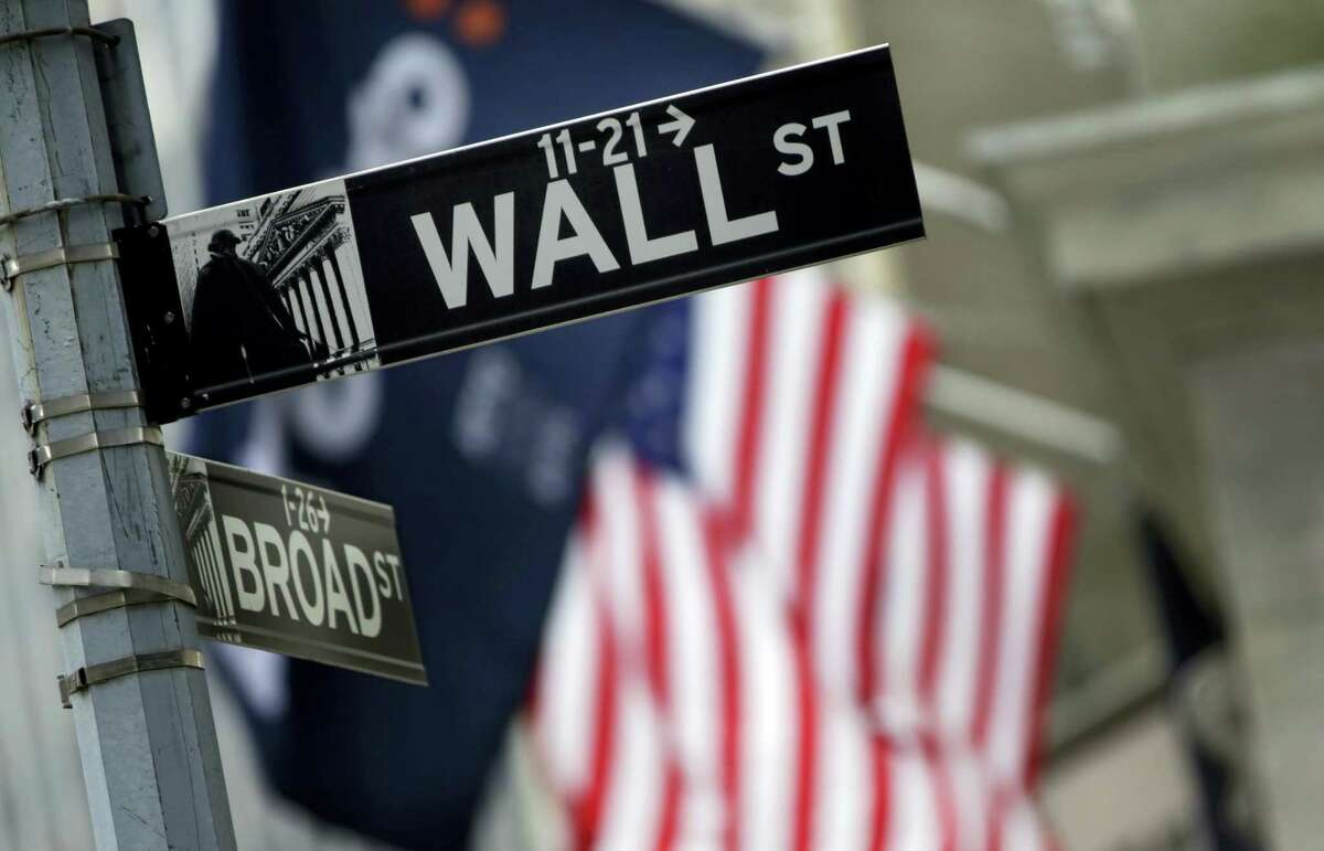 FILE - This Thursday, Oct. 2, 2014, file photo, shows a Wall Street sign adjacent to the New York Stock Exchange. Stocks rose in early trading Friday, Aug. 26, 2016, following two days of declines after Federal Reserve Chair Janet Yellen gave an upbeat assessment on the U.S. economy.