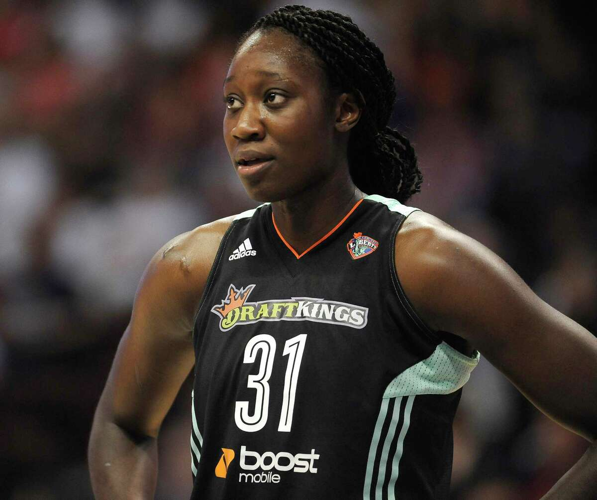 In this Aug. 14, 2015 photo, New York Liberty's center Tina Charles wears a jersey printed with the logo of the daily fantasy sports company DraftKings during the first half of a WNBA basketball game in Uncasville, Conn.