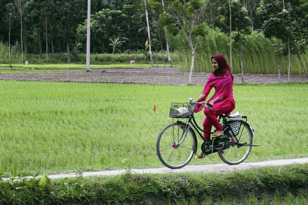 A girl rides a cycle after Bangladesh and India officially exchanged the adversely possessed enclaves at Dashiarchhara in in Kurigram district, 240 kilometers (150 miles) north of Dhaka, Bangladesh's capital, Saturday. Tens of thousands of stateless people who were stranded for decades along the poorly defined border between India and Bangladesh can finally choose their citizenship, as the two countries swapped more than 150 pockets of land at the stroke of midnight Friday to settle the demarcation line dividing them.