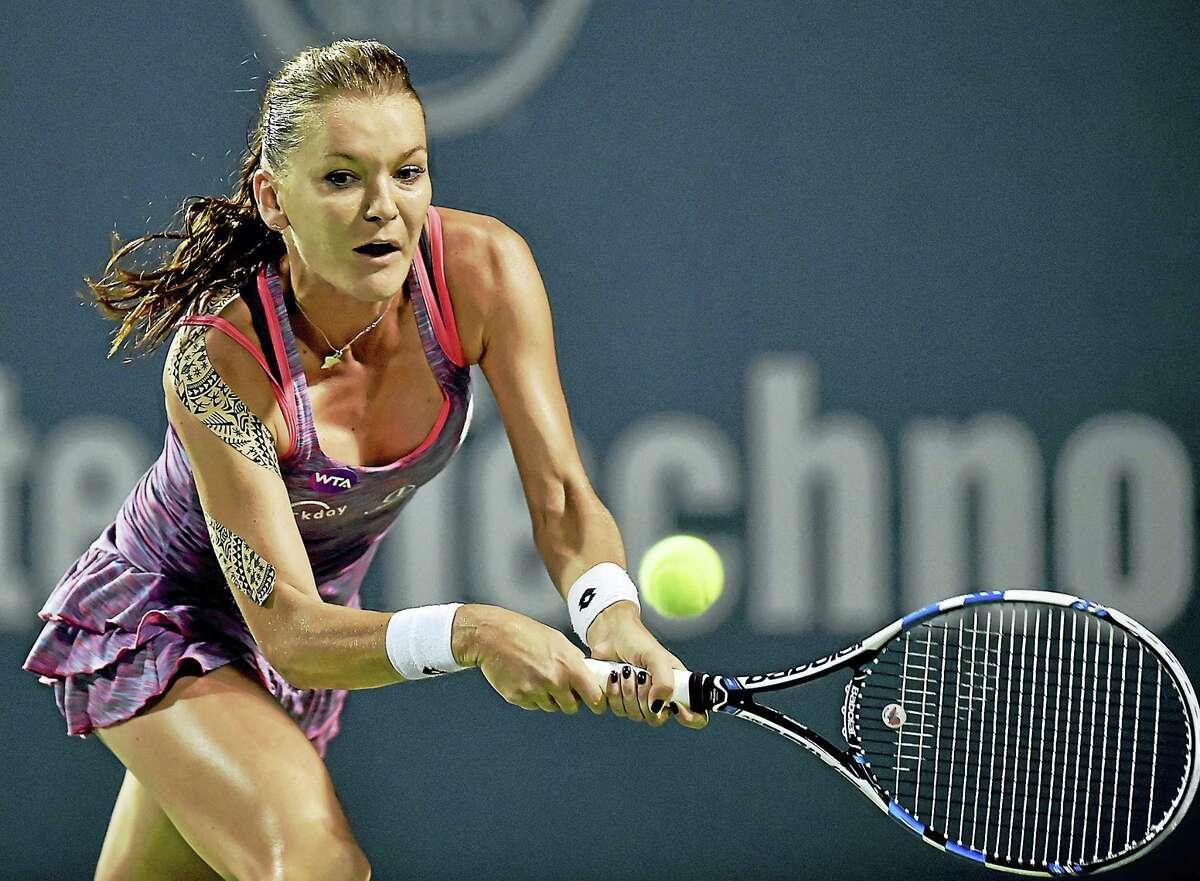 Poland's Agnieszka Radwanska defeated Belgium's Kristen Flipkens in a quarterfinal match at the Connecticut Open on Thursday.
