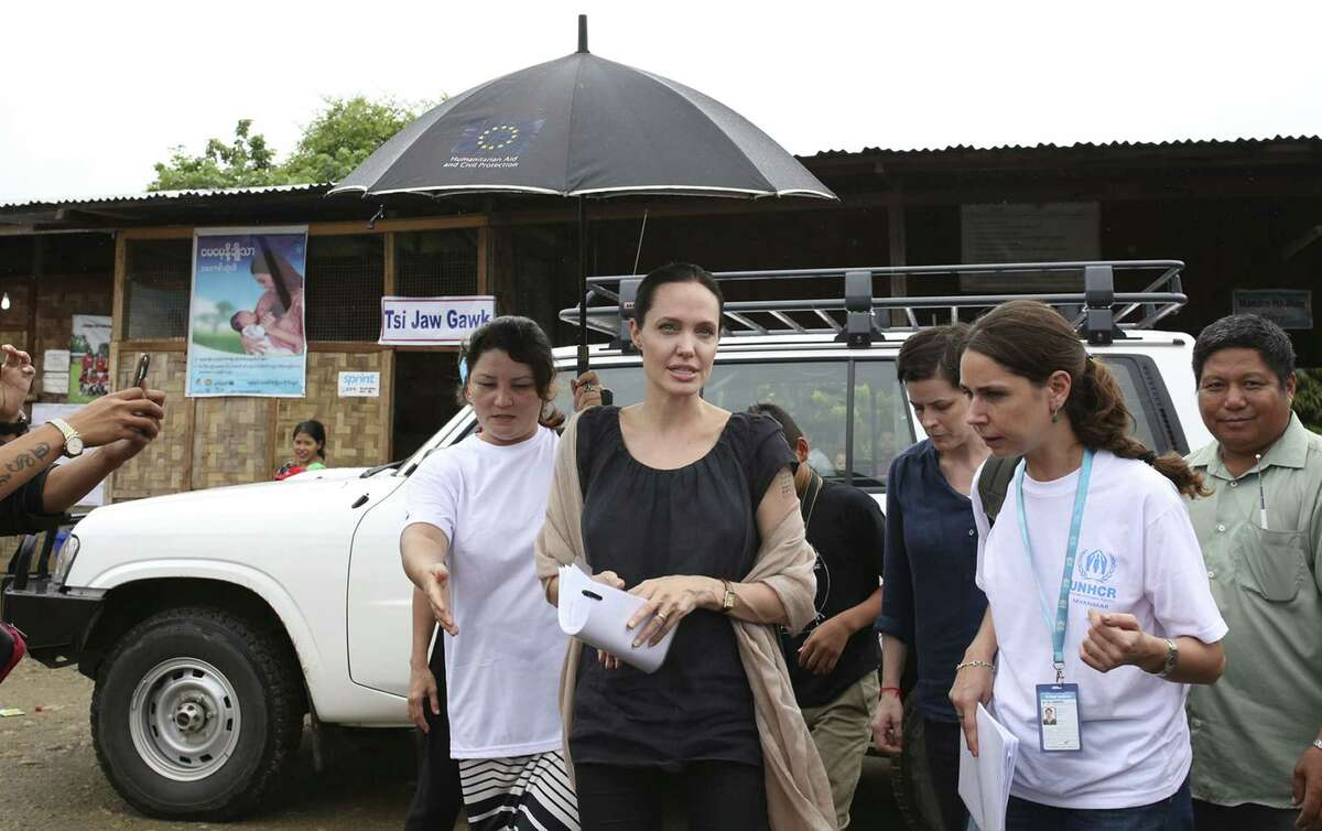 Actress Angelina Jolie Pitt, United Nations High Commissioner for Refugees, special envoy and co-founder of the Preventing Sexual Violence Initiative, visits Jan Mai Kaung refugee camp in Myitkyina, Kachin State, Myanmar, Thursday. The refugees have fled fighting between the Burmese government and the Kachin Independence Army since 2011.