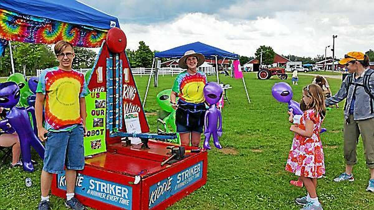 4-H Club members Sean Kelchner and Carol Pelizzari sold customized-art alien balloons as a fundraiser for her robotics club on Saturday afternoon at the 83rd Litchfield County 4-H Fair at the Goshen Fairgrounds at 116 Old Middle St. in Goshen.