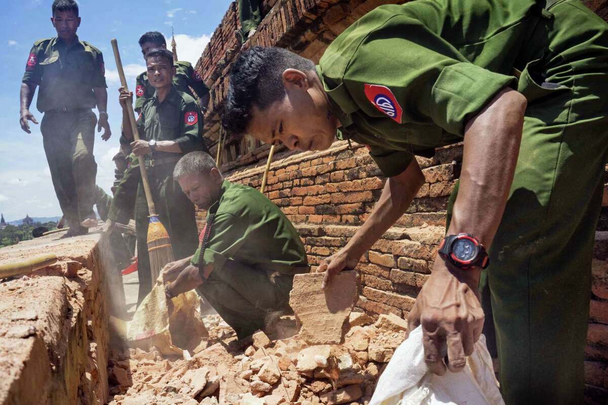 Myanmar Military personnel examine the Htilominlo Pagoda in Bagan, Myanmar on Aug. 25, 2016.