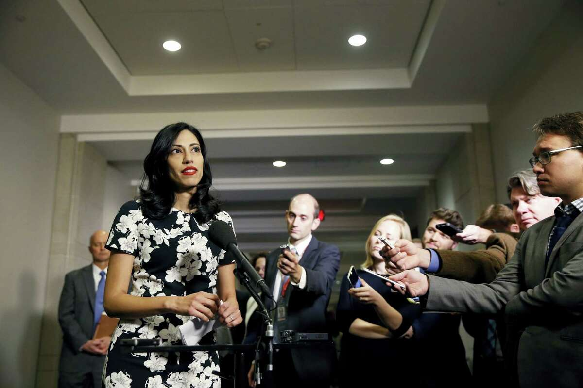 In this Oct., 16, 2015 file photo, Huma Abedin, a longtime aide to Hillary Rodham Clinton, speaks to the media after testifying at a closed-door hearing of the House Benghazi Committee, on Capitol Hill in Washington. The longtime Hillary Clinton aide at the center of a renewed FBI email investigation testified under oath four months ago she never deleted old emails, despite promising in 2013 not to take sensitive files when she left the State Department.