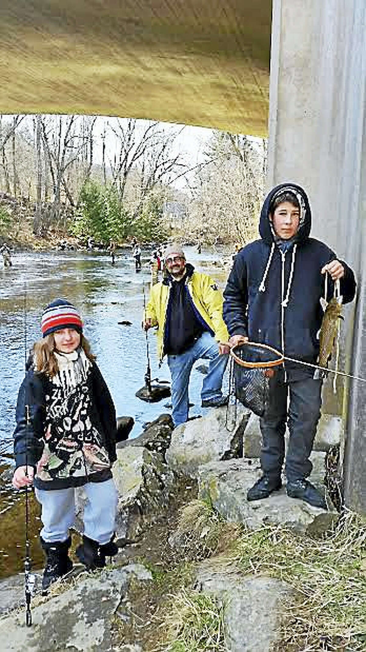 Azyda Lynt, 11, of Terryville; Derek Paplauskas of Terryville; and Robert Valentine, 16, of Waterbury participated in the 67th annual Riverton Fishing Derby on the West branch of the Farmington River near the Old Riverton Inn at 436 E. River Road in Riverton Saturday.