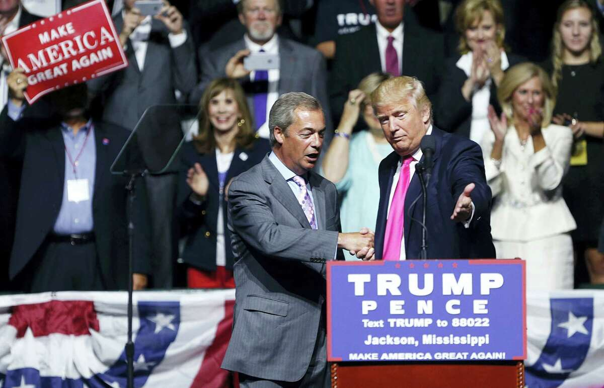 Republican presidential candidate Donald Trump welcomes Nigel Farage, ex-leader of the British UKIP party, to speak at a campaign rally in Jackson, Miss., Wednesday, Aug. 24, 2016.