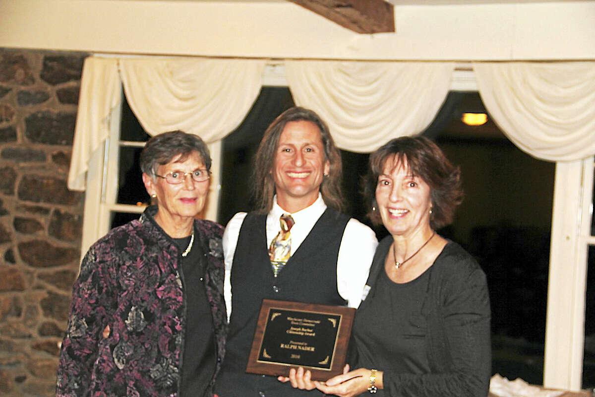 Photo by Anita GarnettCommunity Lawyer Charlene Lavoie, right, accepts the Joseph Barber Citizenship Award on behalf of Ralph Nader.