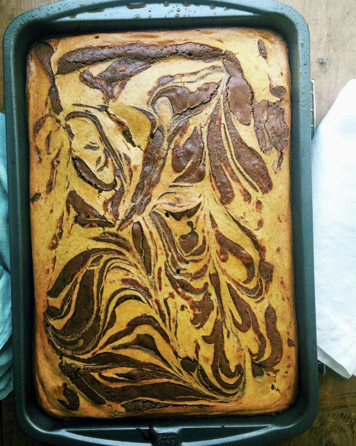 Pumpkin cheesecake brownies are the perfect dessert for fall.