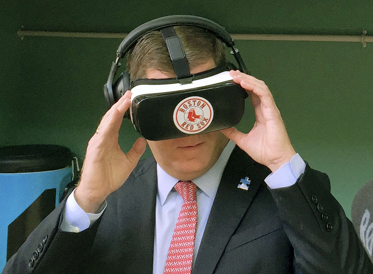 Boston Mayor Marty Walsh tries out a virtual reality device during a tour of the latest improvements at Fenway Park on Friday.