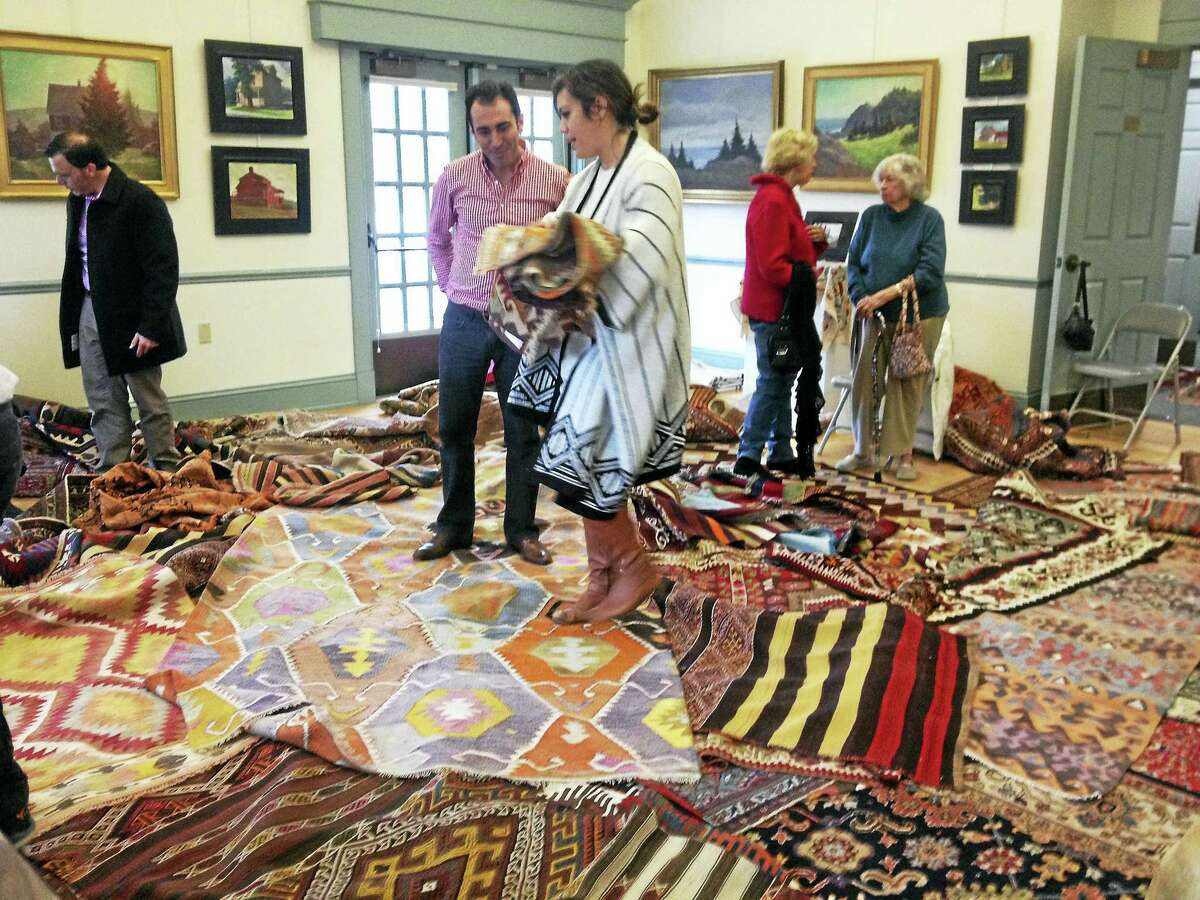 Contributed photo The Gunn Historical Museum, the Roxbury Museum & Hodge Memorial Library, and the Minor Memorial Library will hold the annual collaborative Turkish-Rug-Sale Fundraiser, on Saturday, Nov. 5 from 12-4 p.m. Above, visitors choose from a selection of rugs during last year's sale.