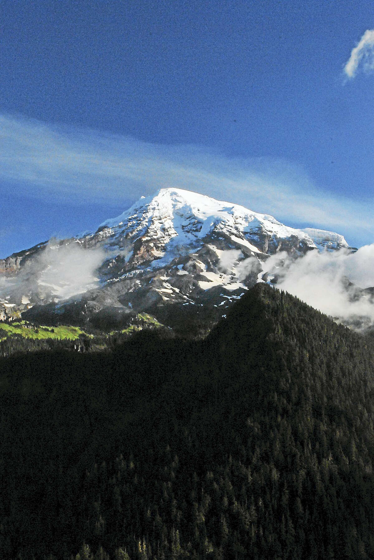 A view of Mt. Rainier just outside of Seattle, Washington. Mt. Rainier National Park is home to Mt. Rainier, an active volcano reaching 14,410 feet above sea level. (Anna Bisaro - New Haven Register)